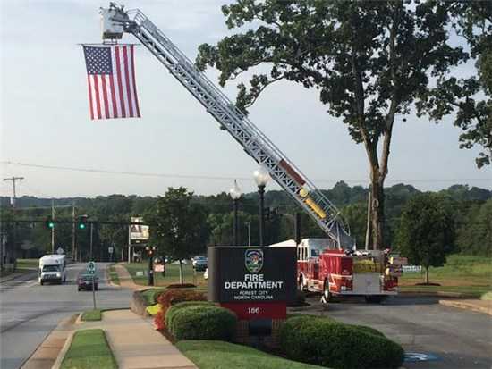 Ladder Truck Fully Extended with Hanging American Flag