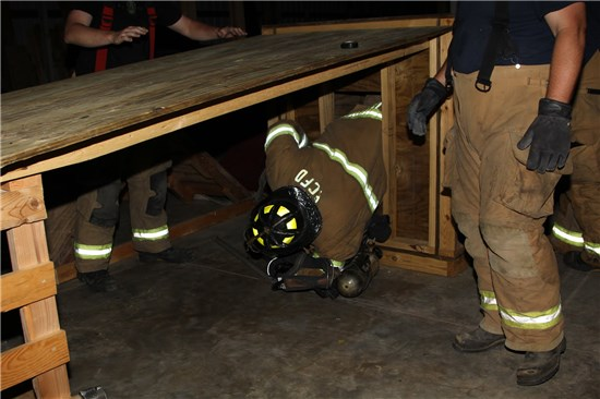 Firefighter Crawling out of Training Facility